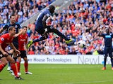 Papiss Cissé of Newcastle United has a shot saved during the Barclays Premier League match between Cardiff City and Newcastle United at Cardiff City Stadium on October 5, 2013