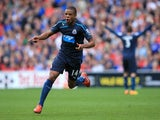 Loïc Rémy of Newcastle United celebrates after scoring a goal during the Barclays Premier League match between Cardiff City and Newcastle United at Cardiff City Stadium on October 5, 2013