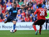 Loïc Rémy of Newcastle United scores his second goal of the match against Cardiff City on October 5, 2013