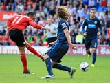 Peter Odemwingie of Cardiff City scores a goal past Fabricio Coloccini of Newcastle United during the Barclays Premier League match between Cardiff City and Newcastle United at Cardiff City Stadium on October 5, 2013
