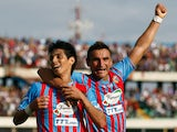Pablo Barrientos of Catania celebrates after scoring the opening goal with his teammate Gonzalo Bergessio during the Serie A match between Calcio Catania and Genoa CFC at Stadio Angelo Massimino on October 6, 2013