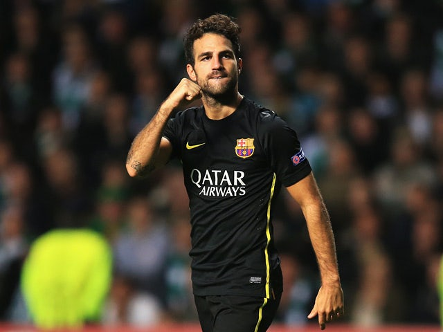 Barcelona's Cesc Fabregas celebrates after scoring the opening goal against Celtic during their Champions League group match on October 1, 2013