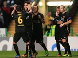 Barcelona's Cesc Fabregas celebrates with teammates after scoring the opening goal against Celtic during their Champions League group match on October 1, 2013