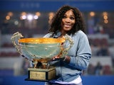 Serena Williams of the United States poses with her trophy during the medal ceremony after winning against Jelena Jankovic of Serbia on day night of the Women's Single Final of the China Open at the China National Tennis Center on October 6, 2013