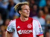 Ajax's Christian Poulsen in action against Barcelona on September 18, 2013