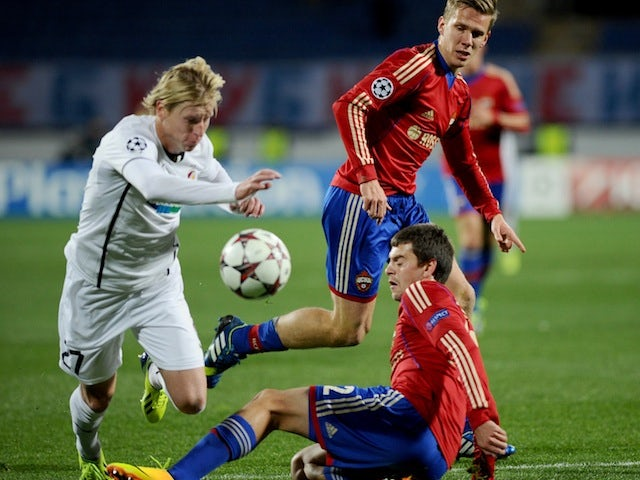 Viktoria Plzen's Frantisek Rajtora (L) vies with CSKA Moscow's Pontus Wernbloom (C) and Georgi Schennikov (R) during their Champions League Group D match on October 2, 2013