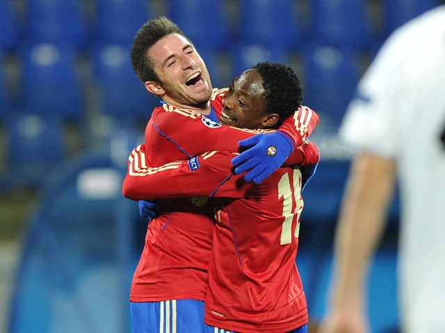CSKA Moscow's Zoran Tosic and Ahmed Musa celebrate during their UEFA Champions League group D match against FC Viktoria Plzen in Saint-Petersburg on October 2, 2013