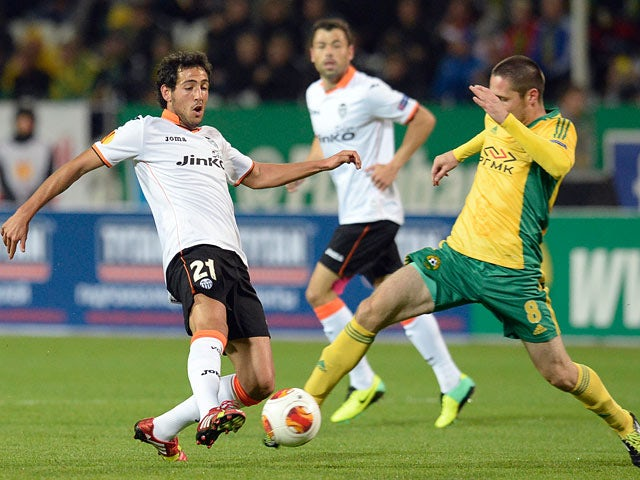 Valencia's Daniel Parejo and Kuban's Artur Tlisov battle for the ball during their Europa League group match on October 3, 2013