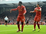 Daniel Sturridge of Liverpool celebrates a goal against Crystal Palace during the Barclays Premier League match at Anfield on October 5, 2013