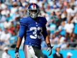 Da'Rel Scott #33 of the New York Giants during their game at Bank of America Stadium on September 22, 2013