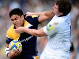 David Lemi of Worcester Warriors is tackled by Adam Powell of Newcatstle Falcons during the Aviva Premiership match between Worcester Warriors and Newcastle Falcons at Sixways Stadium on October 5, 2013