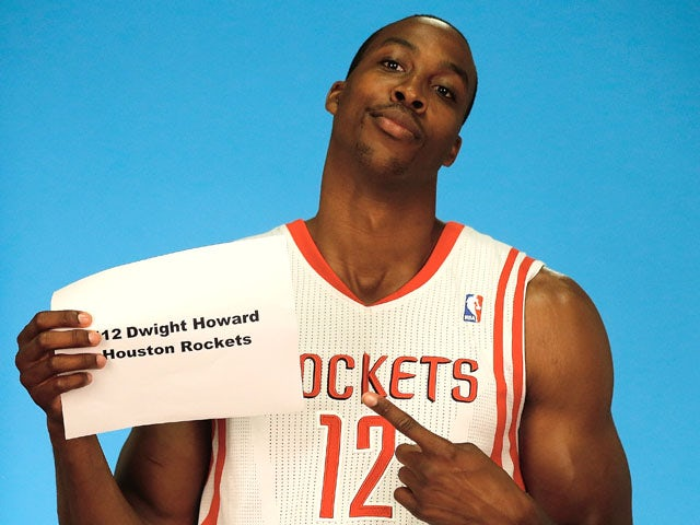Dwight Howard #12 of the Houston Rockets poses for a team photographer during Houston Rockets Media Day at the Toyota Center on September 27, 2013