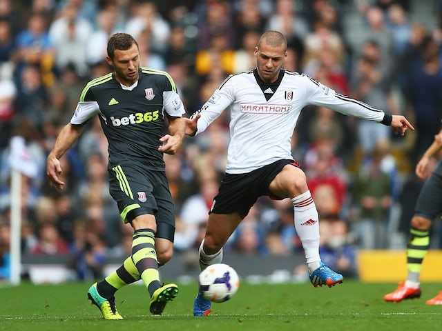 Stoke's Erik Pieters and Fulham's Pajtim Kasami battle for possession during their Barclays Premier League match at Craven Cottage on October 5, 2013