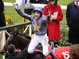 Frankie Dettori celebrates winning The Betfred Cesarewitch at Newmarket racecourse on Never Can Tell on October 8, 2011
