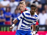 Gareth McCleary of Reading holds off the challenge of Elliot Hewitt of Ipswich during the Sky Bet Championship match between Reading and Ipswich Town at the Madejski Stadium on August 03, 2013