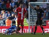 Grant Hanley of Blackburn Rovers is sent off by referee Mr Stuart Attwell during the Sky Bet Championship game against Wigan on October 6, 2013