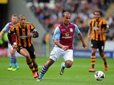 Gabriel Agbonlahor of Aston Villa is pursued by Curtis Davies of Hull during the Barclays Premier League match between Hull City and Aston Villa at KC Stadium on October 5, 2013