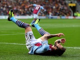 Antonio Luna of Aston Villa reacts after a missed chance on goal during the Barclays Premier League match between Hull City and Aston Villa at KC Stadium on October 5, 2013