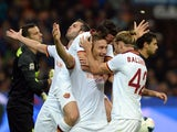 Francesco Totti of AS Roma celebrates scoring the second goal during the Serie A match between FC Internazionale Milano and AS Roma at Stadio Giuseppe Meazza on October 5, 2013