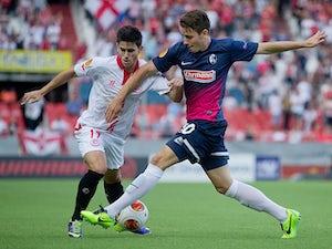 Ten-man Sevilla win first leg of Copa tie