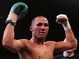 British boxer James DeGale celebrates his win over Piotr Wilczewski on October 15, 2011
