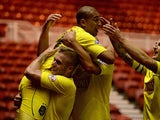 Huddersfield's James Vaughan celebrates with teammates after scoring the opening goal against Middlesbrough during their Championship match on October 1, 2013