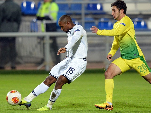 Tottenham's Jermain Defoe scores the opening goal against Anji Makhachkala during their Europa League group match on October 3, 2013