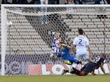 Bordeaux' Brazilian Jussie scores in Sochaux' goalkeeper Simon Pouplin nets during the Ligue 1 football match between Bordeaux and Sochaux on October 6, 2013