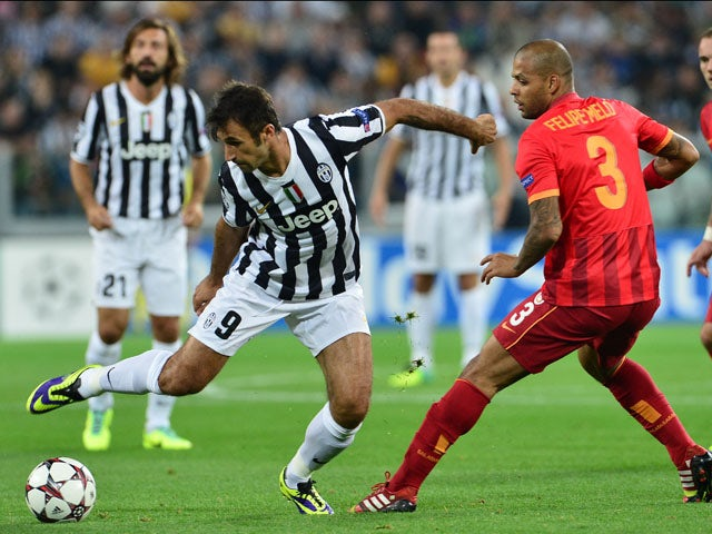 Juventus forward Mirko Vucinic tries to get past Galatasaray's midfielder Felipe Melo during their group B Champions League match between Juventus and Galatasaray at Juventus Stadium Turin on October 2, 2013