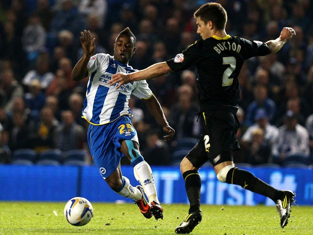Brighton's Kazenga LuaLua and Wednesday's Lewis Buxton battle for the ball during their Championship match on October 1, 2013
