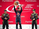 Lotus driver Kimi Raikkonen of Finland and Lotus driver Romain Grosjean of France applaud Red Bull driver Sebastian Vettel of Germany, as he celebrates after winning the Formula One Korean Grand Prix in Yeongam on October 6, 2013