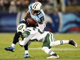 Kyle Wilson #20 of the New York Jets tackles Nate Washington #85 of the Tennessee Titans on December 17, 2012