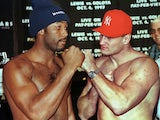 British boxer Lennox Lewis squares up to Poland's Andrew Golota following their weigh-in in Atlantic City on October 2, 1997