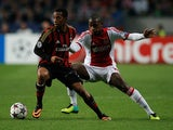 Ajax's Lerin Duarte and Milan's Robinho battle for the ball during their Champions League group match on October 1, 2013