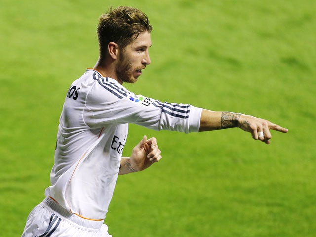 Real Madrid's defender Sergio Ramos celebrates after scoring during the Spanish league football match Levante UD vs Real Madrid CF at the Ciutat de Valencia stadium in Valencia on October 5, 2013