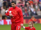 Luis Suarez of Liverpool with his new baby and daughter prior to the Barclays Premier League match between Liverpool and Crystal Palace at Anfield on October 5, 2013