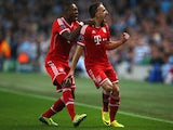 Franck Ribery celebrates after scoring against Manchester City during the Champions League match on October 2, 2013