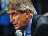 Manuel Pellegrini, coach of Manchester City looks on during the UEFA Champions League Group D match between Manchester City and FC Bayern Muenchen at Etihad Stadium on October 2, 2013