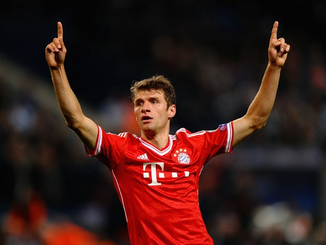 Thomas M�ller of Bayern Munich celebrates scoring against Manchester City during the Champions League match on October 2, 2013