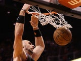 Marcin Gortat #4 of the Phoenix Suns slam dunks the ball against the Boston Celtics during the NBA game at US Airways Center on February 22, 2013