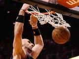 Marcin Gortat #4 of the Phoenix Suns slam dunks the ball against the Boston Celtics during the NBA game at US Airways Center on February 22, 2013