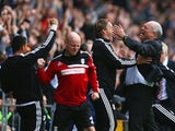Fulham manager Martin Jol celebrates Darren Bent's winner against Stoke City in the Barclays Premier League match on October 5, 2013
