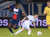 Marseille  midfielder Mathieu Valbuena vies with PSG's Blaise Matuidi during the Ligue 1 match on October 6, 2013