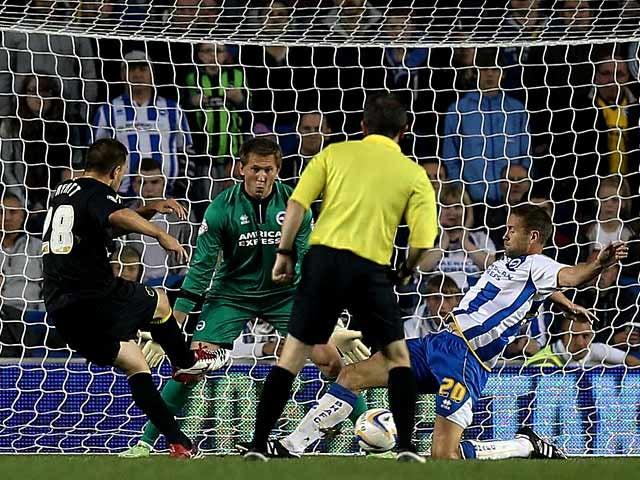 Wednesday's Matty Fryatt scores the opening goal against Brighton during their Championship match on October 1, 2013