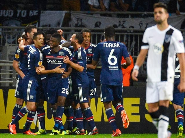 Lyon's Maxime Gonalons is congratulated by teammates after scoring the equaliser against Vitoria de Guimaraes during their Europa League group match on October 3, 2013