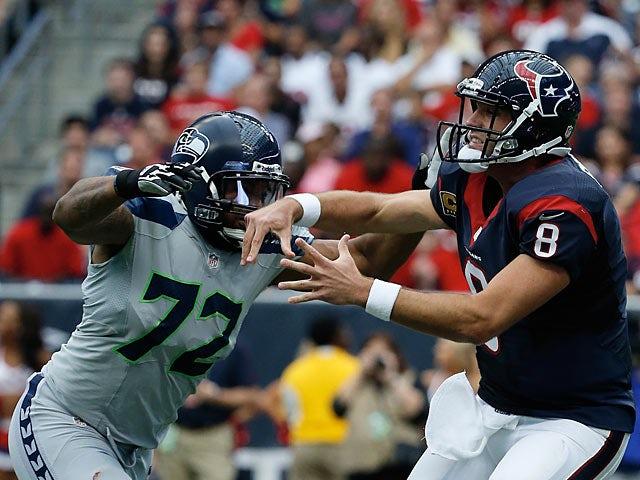 Seattle Seahawks' Michael Bennett defends against Houston Texans' Matt Schaub on September 29, 2013