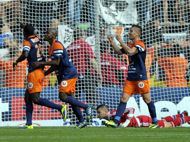 Montpellier's players celebrate after scoring during the French L1 football match Montpellier vs Lyon on October 6, 2013