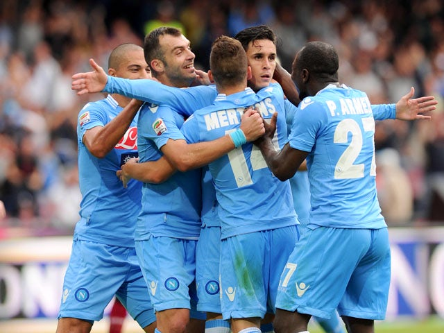 Jos� Maria Callejon of Napoli celebates with team mates after scoring the goal 3-0 during the Serie A match between SSC Napoli and AS Livorno Calcio at Stadio San Paolo on October 6, 2013