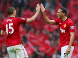 Nemanja Vidic and Rio Ferdinand celebrates the latter's winning goal for Manchester United against Swansea City in May 2013.