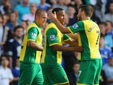 Robert Snodgrass of Norwich City celebrates with Martin Olsson of Norwich City after Anthony Pilkington of Norwich City scores their first goal during the Barclays Premier League match between Norwich City and Chelsea at Carrow Road on October 6, 2013